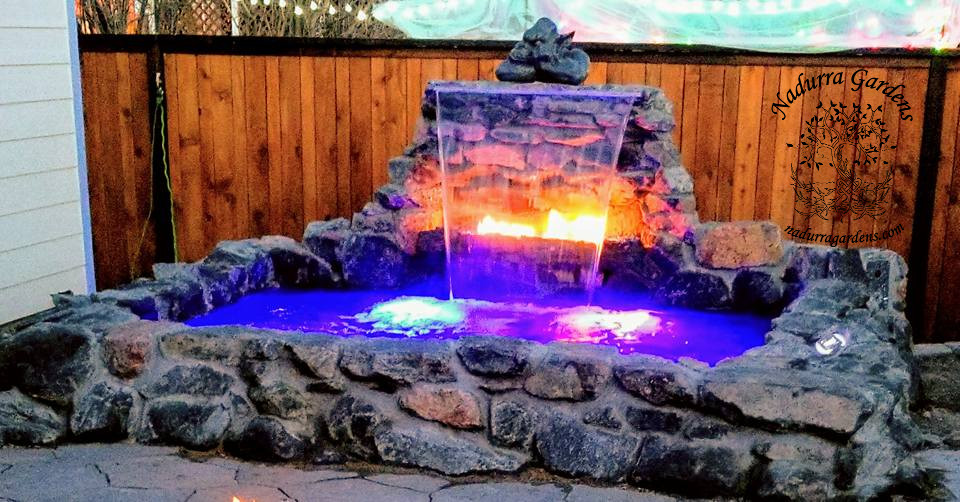 DIY hot tub with waterfall and fire feature